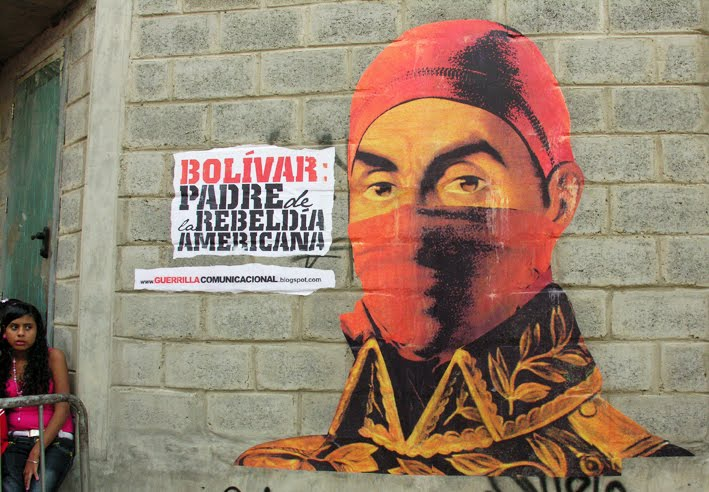 """Using a combination of printed images, wheatpaste, and paints, Venezuela's Communicational Guerrilla modernized and urbanized the image of Simon Bolivar, """"Father of American Rebellion"""" as they describe him."""