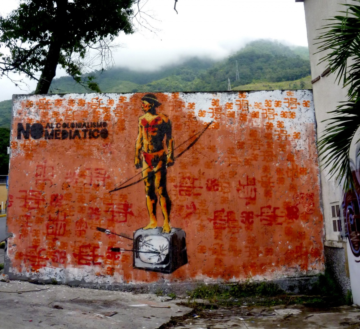 """In the struggle to resist modern-day forms of neocolonialism, including domination via thought/media, the Communicational Guerrilla produced this 10-foot high mural that reads, """"No to Media Colonialism."""""""