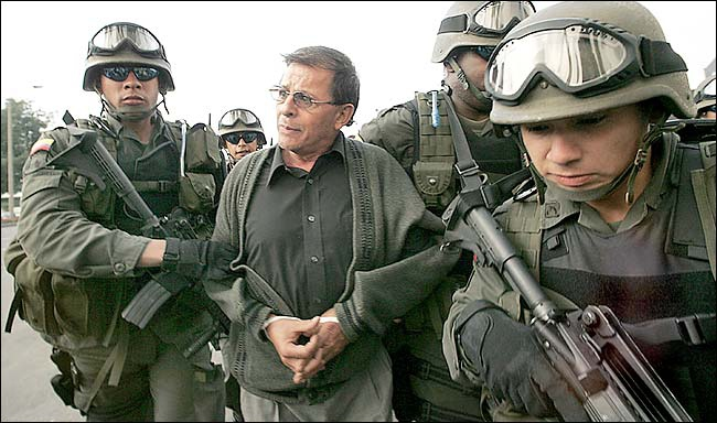 """Rodrigo Granda, """"foreign minister"""" of the Armed Revolutionary Forces of Colombia (FARC), after being kidnapped in Caracas, Venezuela on 13 December 2004 as part of an operation of Colombia's security forces (Archive)."""