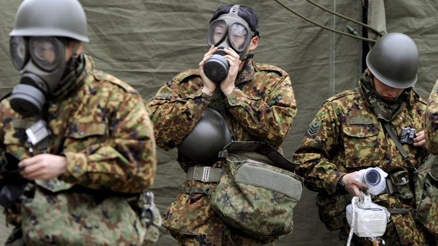 Japanese soldiers gear up to help with clean up efforts in the aftermath of last week's devastating earthquake that left several nuclear power plants damaged and at risk of further melt downs (AP).