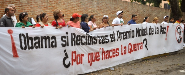 Protesters gathered outside of the Libyan Embassy in Caracas on Sunday, 20 March 2011, to stand in solidarity with the Libyan people as NATO aircraft began their bombing campaign. 