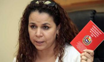 Iris Varela, Venezuela's first Minister of Penitentiary Services, holding a copy of the country's constitution (Agencies).
