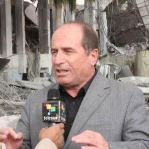 Venezuela's Ambassador in Libya, Afif Tajeldine, speaking in front of rubble from a NATO bombing in Libya (Agencies).