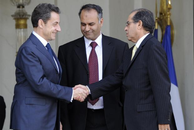 French President Nicolas Sarkozy with an unnamed member of Libya's Interim Transitional National Council (Agencies).