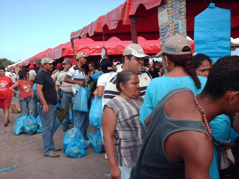 """A """"Christmas fair"""", this one carried out by a Barcelona mayor. For sale were 80 tonnes of food used to create the traditional hallacas (meats, olives, capers etc wrapped in corn dough and a banana leaf and cooked) sold at """"solidarity"""" prices (PSUV)"""