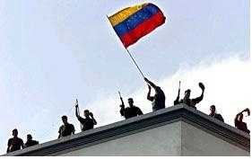 April 13 2002: Following massive protests by Chavez supporters outside the presidential palace, the National Guard organise and recover the palace from the coup plotters (agencies).