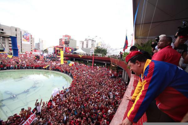 President Hugo Chavez addressed the crowd after he registered as a candidate (agencies)