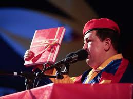 President Chavez with the plan on the day he registered to be a candidate (patriagrande)