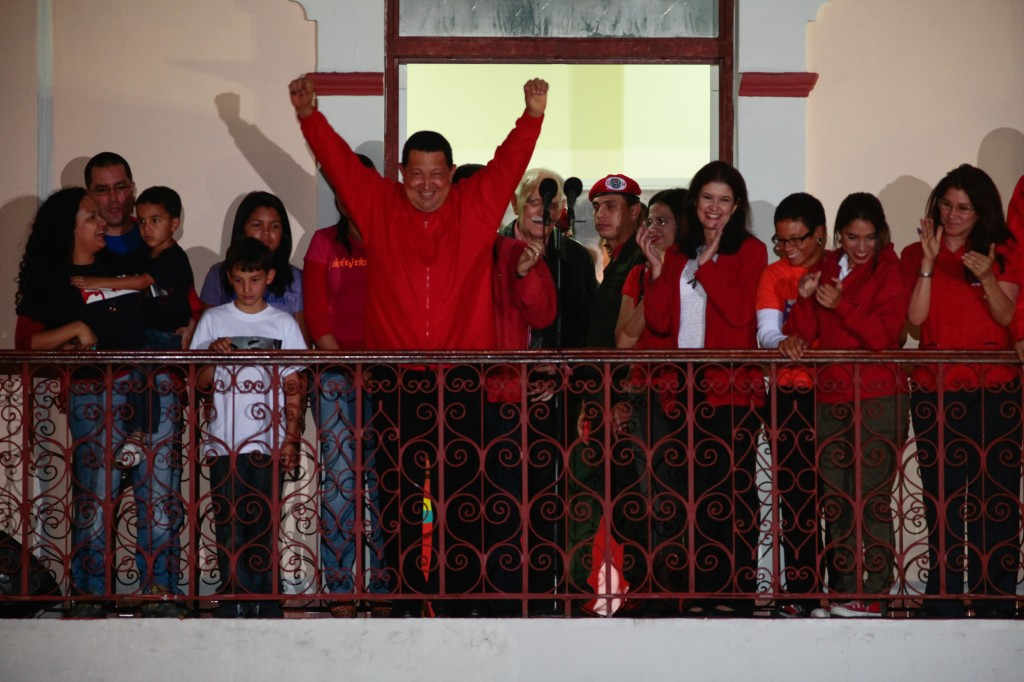 "Hugo Chavez celebrated his election triumph with a mass crowd of supporters from the presidential palace's ""Balcony of the People"" in Caracas (Miguel Angulo)"