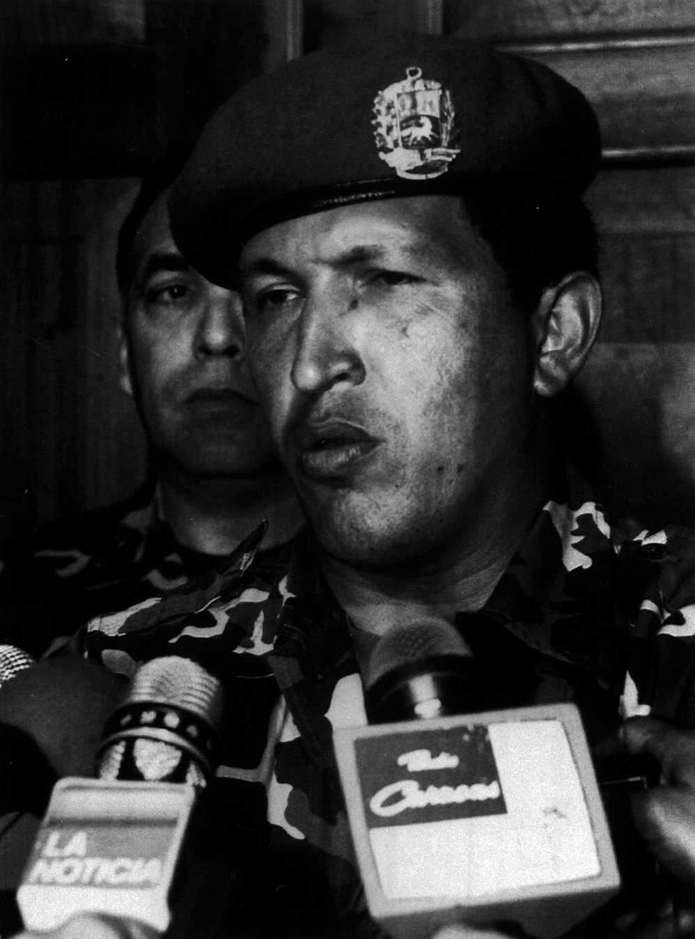 "Hugo Chavez telling comrades to lay down their arms and that the movement's objectives had not been achieved ""for now"". Just under seven years later he would be elected Venezuelan president. (AP)"