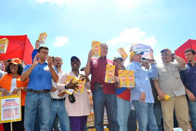 Opposition leaders hold fake packages of corn flour as part of a campaign stunt against food shortages