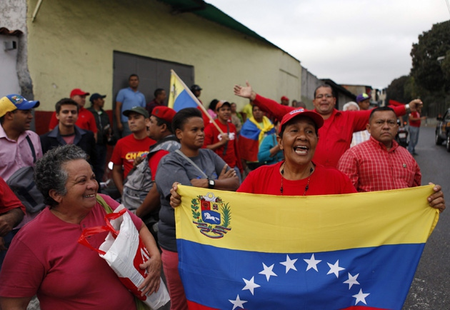 Supporters outside the Dr. Carlos Arvelo military hospital in Caracas, where Hugo Chavez will continue treatment after returning from Cuba this morning (EFE)