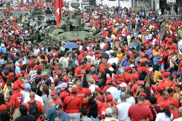 Thousands of civilians and members of the military filled the streets of Caracas on Monday in celebration of the anniversary of the 1992 coup attempt (AFP Photo)