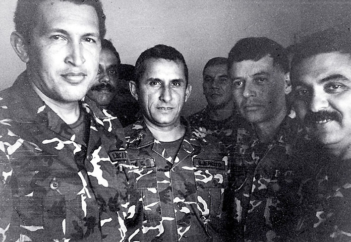 Chavez (left) with fellow jailed revolutionaries, following the failed 1992 coup