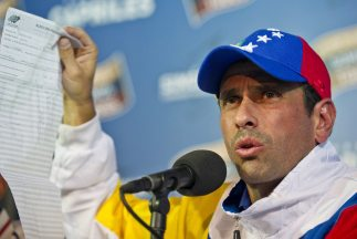 Henrique Capriles holds up a vote tally at a press conference last Monday (Getty Images)