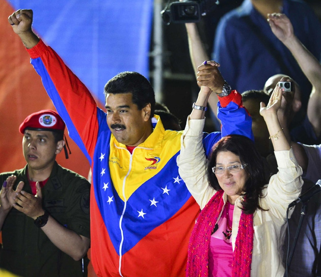 Newly elected President of Venezuela Nicolas Maduro and his wife Celia Flores after the electoral victory on Sunday evening. (AFP / Luis Acosta)