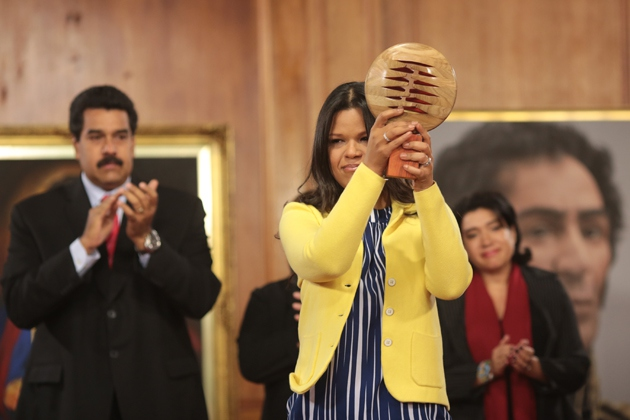 The prize was handed to Chavez's daughter, Maria Chavez, by President Nicolas Maduro during a ceremony in Venezuela's presidential palace last night (Prensa Miraflores)