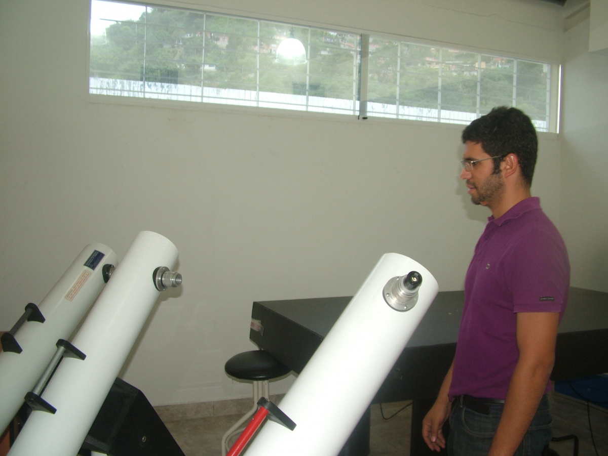 Elias Sanchez with some of the telescope prototypes (Tamara Pearson/ Venezuelanalysis.com)