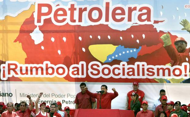 Hugo Chavez addresses oil workers in 2007, pushing for more national control of the country's oil (archive)