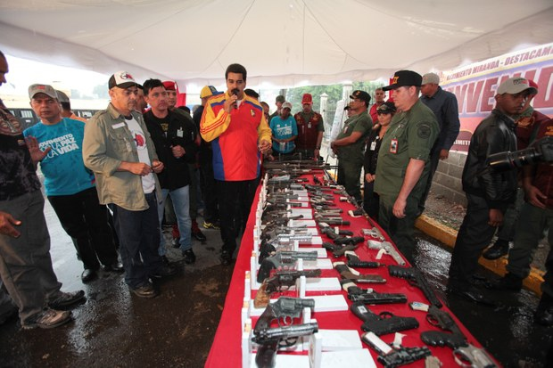 Maduro oversaw the deactivation of weapons from 97 armed groups in Caracas on Thursday (VTV)