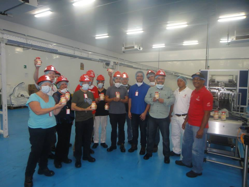 Factory workers with AVSN brigade members. Workers highlighted that the government had invested in new technology to open new production lines, which was aiding the increase in production. The technology was brought from Europe and assembled by the workers (Denis Sergeyevich Rogatyuk)