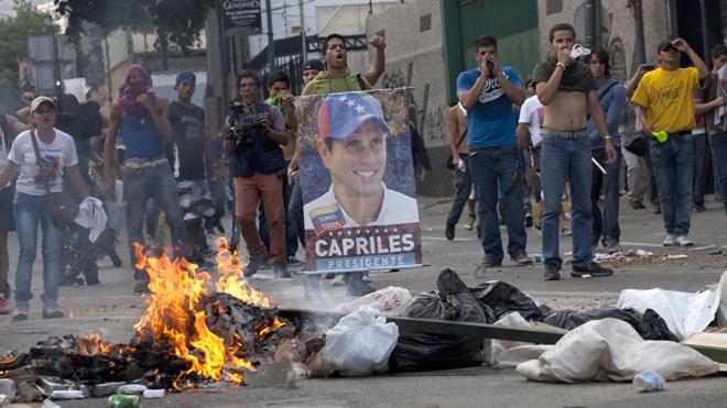 Protests in April 2013. (AP Photo/Ramon Espinosa)