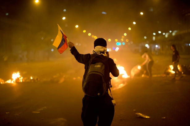 An anti-government demonstrator in the Altamira neighborhood of Caracas, Friday, February 21, 2014 (AP Photo/Rodrigo Abd)