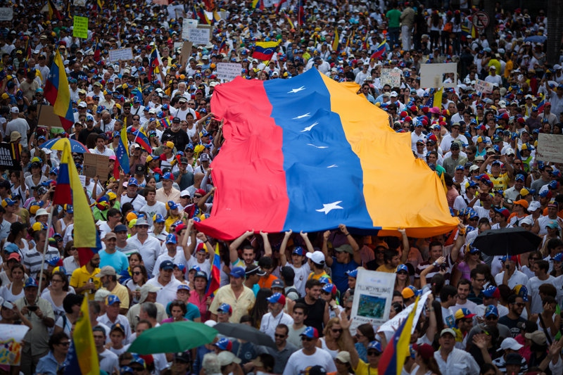 On Sunday many thousands of opposition supporters peacefully marched through Caracas to underscore their discontent. (Federico Parra)