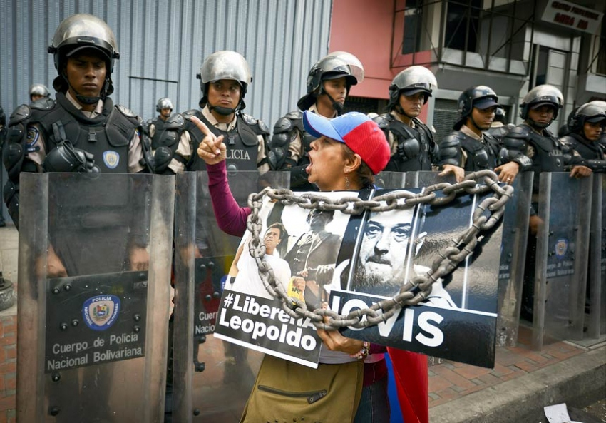 An anti-government protester shouts at police officers during a march against Venezuelan President Nicolás Maduro in Caracas on March 29. (Juan Barreto/AFP/Getty Images)