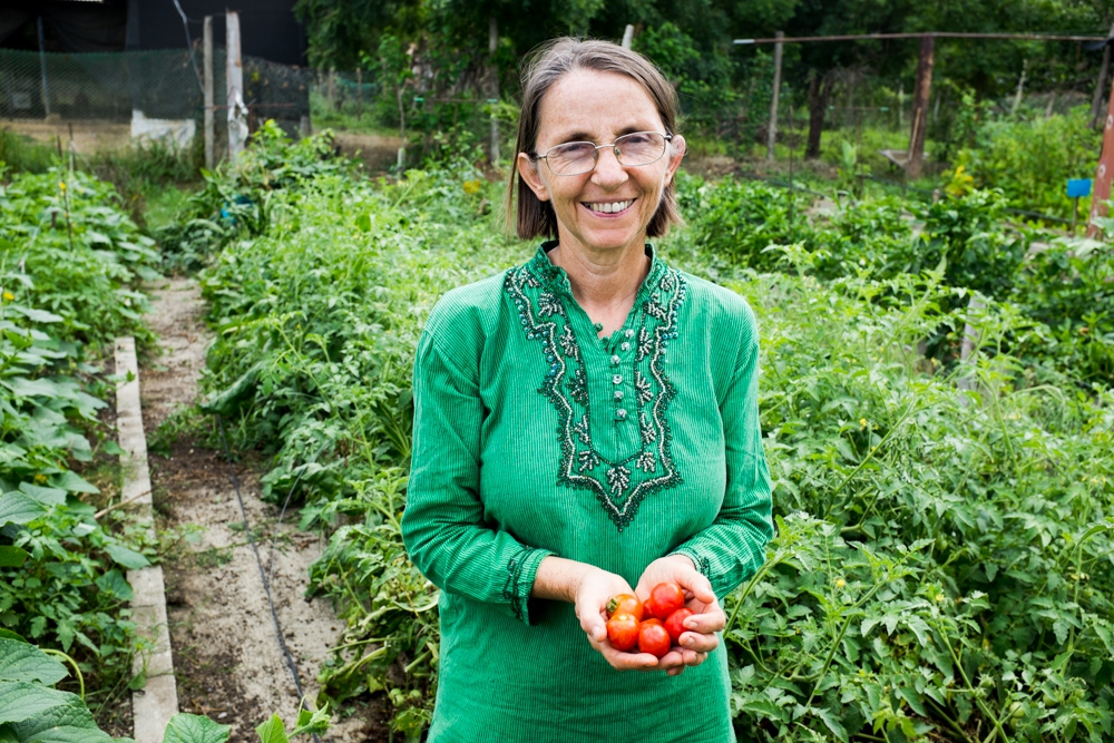 Didi Ananda Sadhana, director of Centro Madre, with the organic seeds project of the farmers' network. (Marcus Murray)