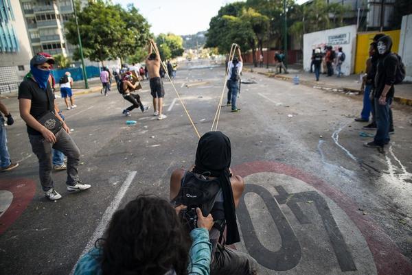 Anti-government protestors in Venezuela. (Carlos Becerra / Creative Commons)