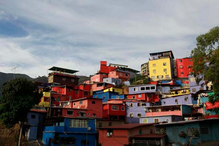"A barrio (informally constructed urban community) in Caracas, with the buildings painted under the urban regeneration social program ""Barrio Nuevo / New Barrio"" (archive)"