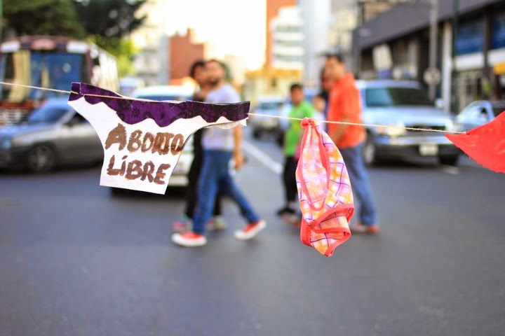 """Panty – shaped signs stating """"free abortion"""" were strung across the avenue in downtown Caracas"""