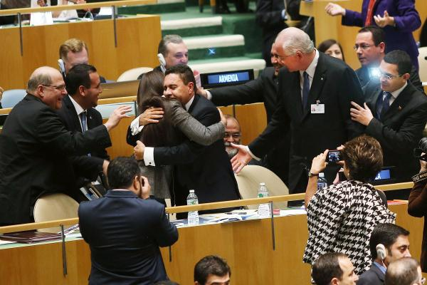 U.N. representatives for Venezuela, including Foreign Minister Rafael Ramirez, right, celebrate after being elected to a two year term as a non-permanent member of the United Nations Security Council. (Spencer Platt/Getty Images)