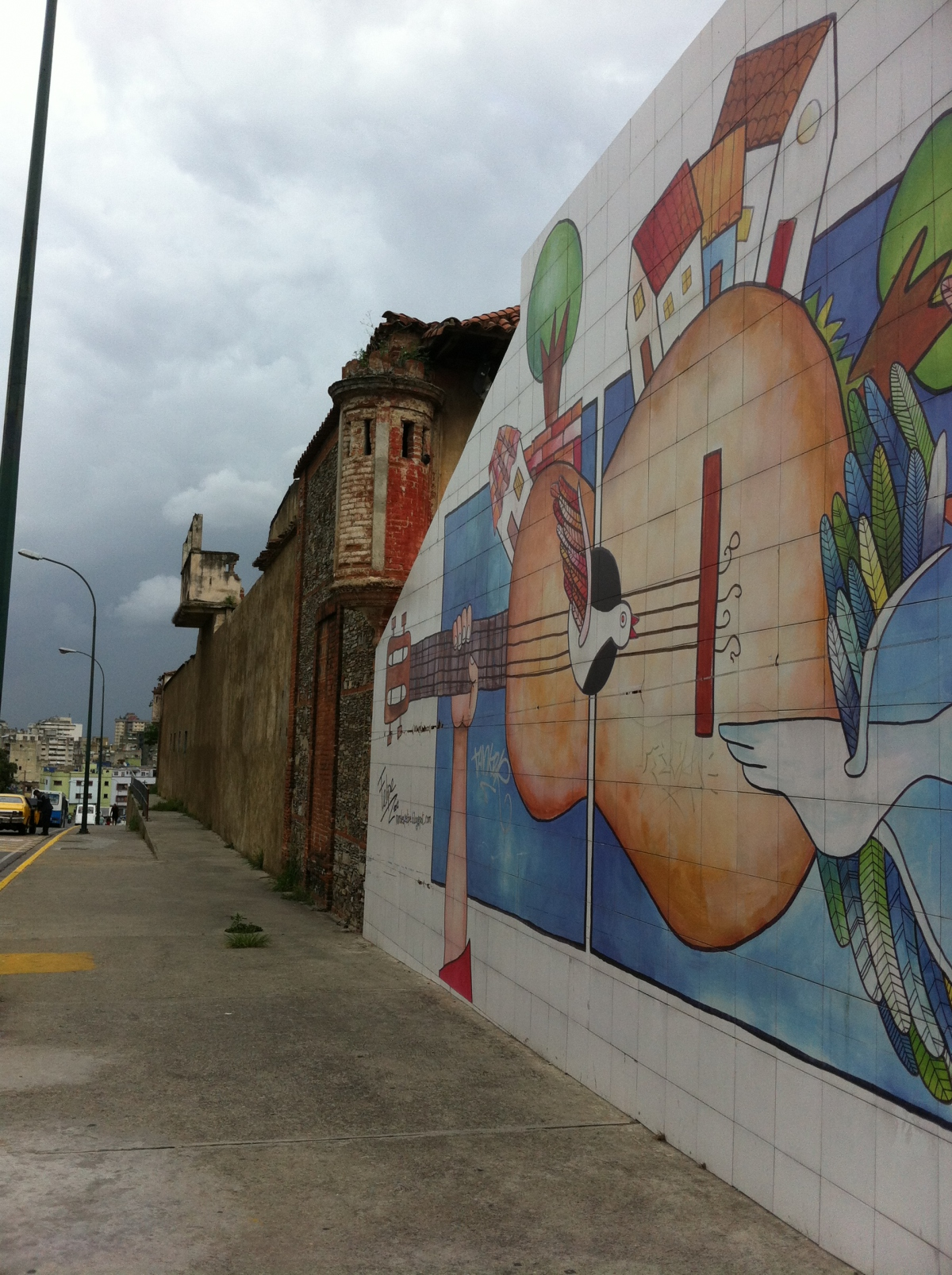 A newer mural painted next to the ancient San Carlos former prison.