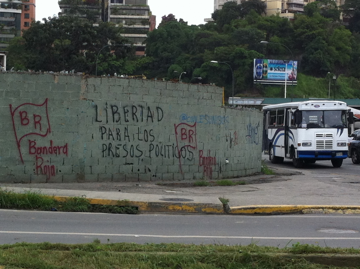"""""""Freedom for Political Prisoners""""spray-painted on a wall in the wealthy neighborhood of Chacaito."""