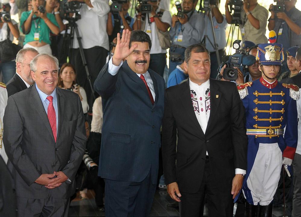 Nicolas Maduro (centre) with Rafael Correa (right) and Ernesto Samper (left) in Quito for the opening ceremony of the new UNASUR HQ today.  (Reuters)