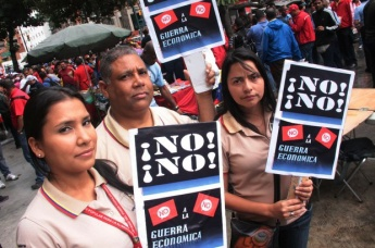 "Trade Unionists hold up signs that say ""No to the Economic War!"" (PHOTO: From Archives)"