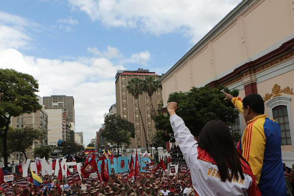 "Venezuelan President, Nicolas Maduro, alongside his wife and ""first combatant,"" Cilia Flores, addressing marchers in Caracas (Alba Ciudad)"