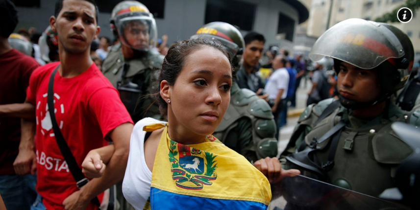 Opposition students next to the National Guards during a march against president Nicolas Maduro's government in Caracas, Venezuela, Feb 12th, 2015. (Jorge Silva/ Reuters)