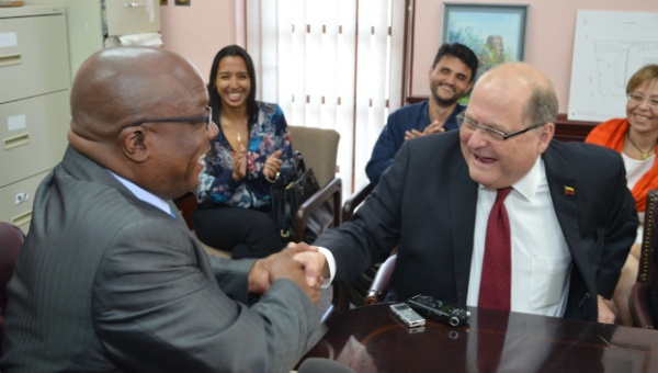 St. Kitts and Nevis' prime minister (L) and Venezuela's ambassador to the country shake hands after sealing a $16M deal to provide support for former sugar industry workers on March 31st. (Photo: Government Information Service - St. Kitts and Nevis)