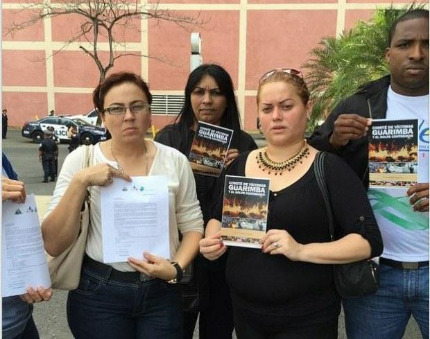 Yendry Velasquez (far left) lost her husband during last year's barricades (VTV)