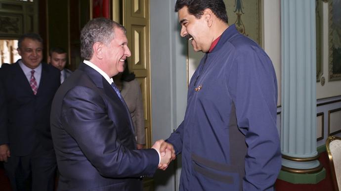 Venezuela's Nicolas Maduro with Rosneft president Sechin (Reuters)
