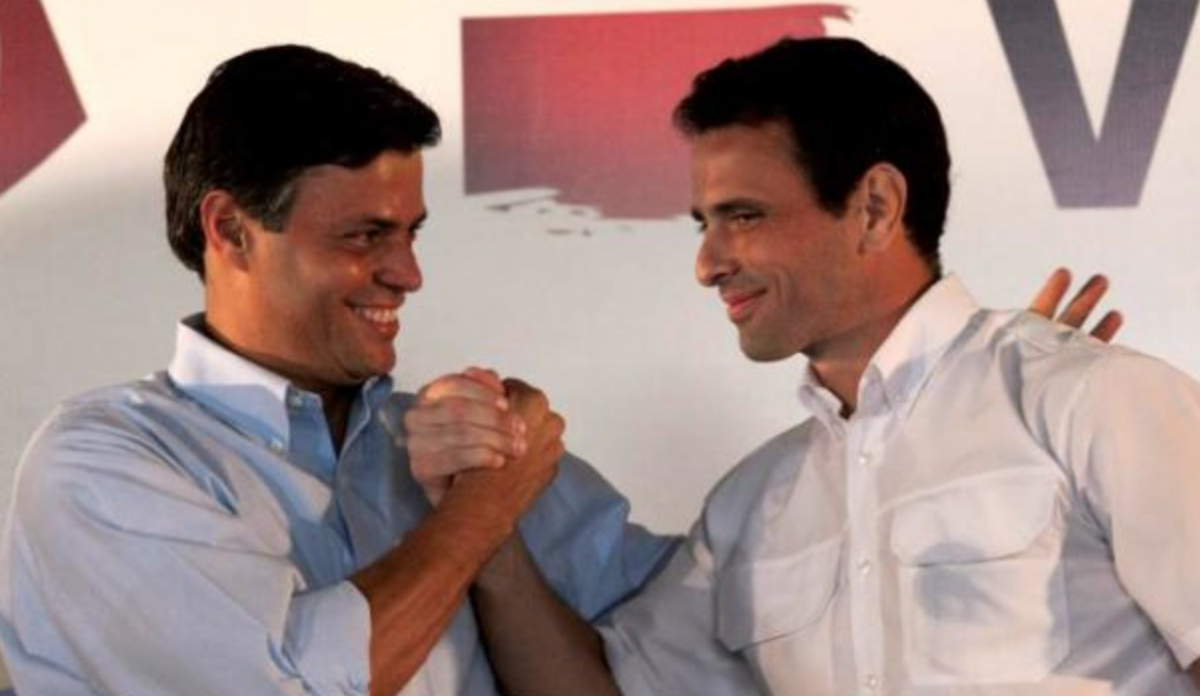 Leopoldo Lopez (far left) and Henrique Capriles Radonski (right) pictured together. Lopez finds himself increasingly isolated from the mainstream Venezuelan opposition (AP)