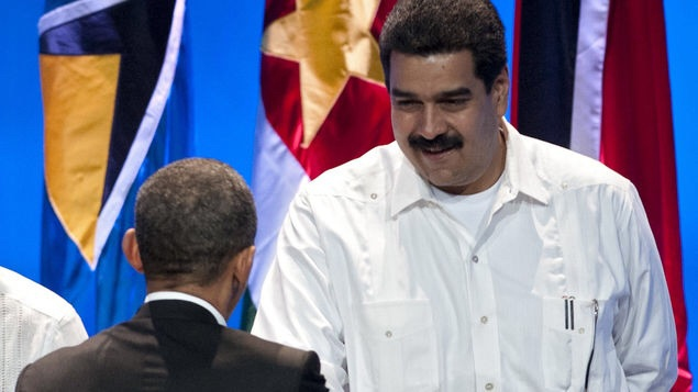 US President Barack Obama (C) shakes hands with Venezuelan Foreign Minister Nicolas Maduro (R) next to Haitian Foreign Minister Laurent Lamothe during the opening remarks of the Summit of the Americas at the Julio Cesar Turbay Ayala Convention Center in Cartagena, Colombia, on April 14, 2012. Saul Loeb / AFP