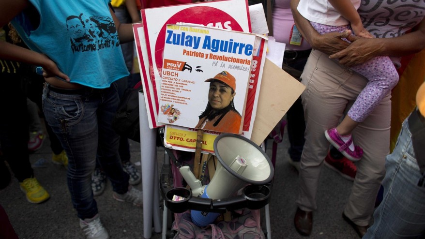 Campaign signs and a bullhorn are propped in a stroller during a closing campaign for the PSUV primaries in Caracas, Venezuela, Friday, June 26, 2015. (AP Photo/Ariana Cubillos)