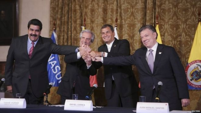 """President Nicolas Maduro (left) and President Santos (right) have agreed to """"normalize ties"""" (Photo: Reuters)"""