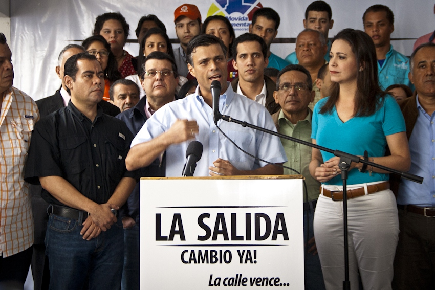 "Leopoldo Lopez (C) speaking at the launching of his destabilization campaign dubbed ""The Exit."" The stand reads ""The Exit, Change Now. The Street Wins..."" (Telesur)"