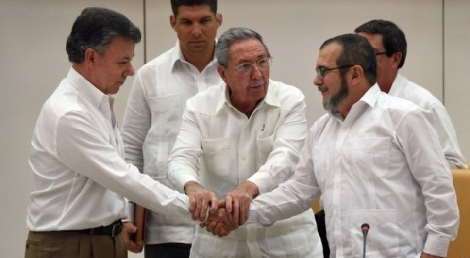 Colombian President Manuel Santos shakes hands with FARC leader Timochenko in Havana on Wednesday (Justice for Colombia).