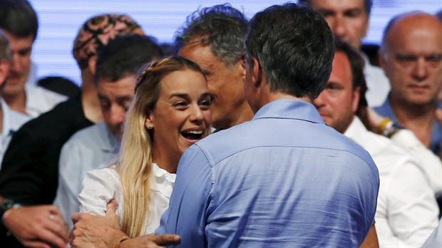Opposition activist Lilian Tintori congratulates Macri on his presidential win. (Reuters)